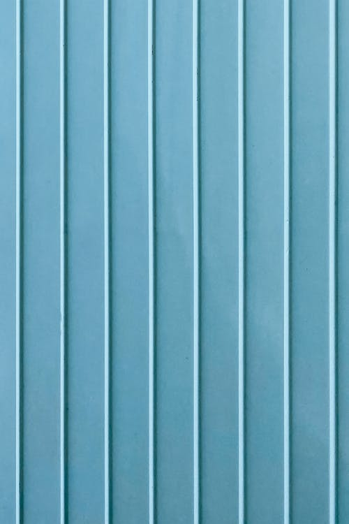 Vertical lines on blue wall