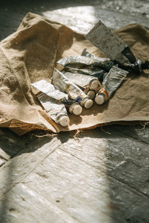 Silver Round Coins on Brown Textile