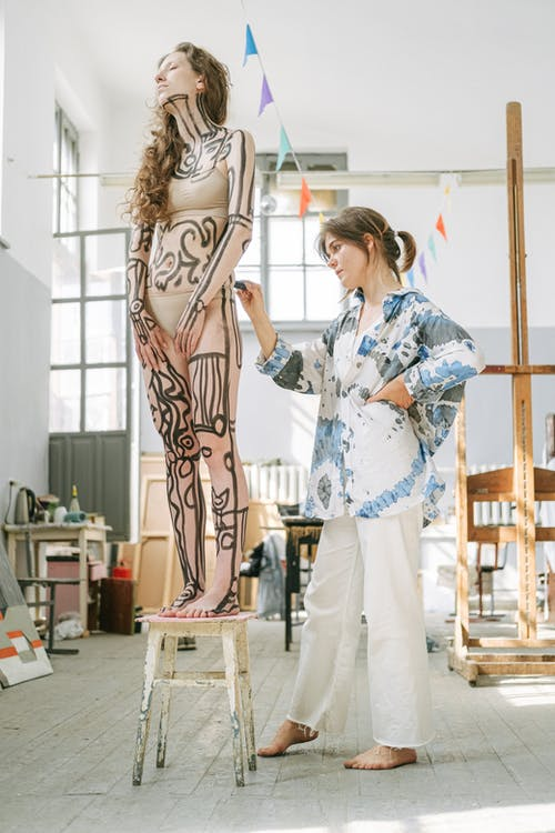 Artist Painting on Woman's Body