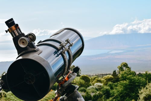 Black and Silver Telescope on Brown and Green Grass Field