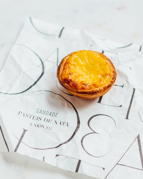 Delicious Portuguese eggs tart on paper