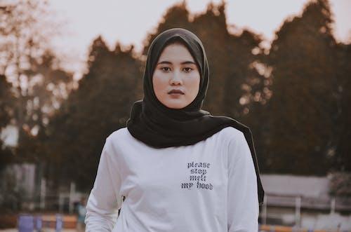 Woman in White Longe Sleeve Shirt and Headscarf
