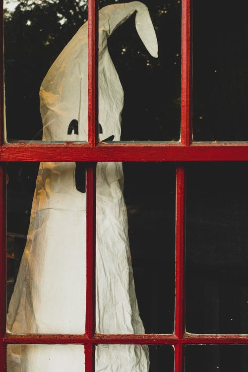 White Plastic Bag on Red Window Frame