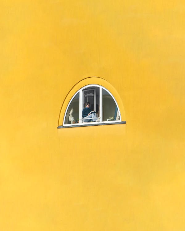 White Framed Glass Window on Yellow Wall