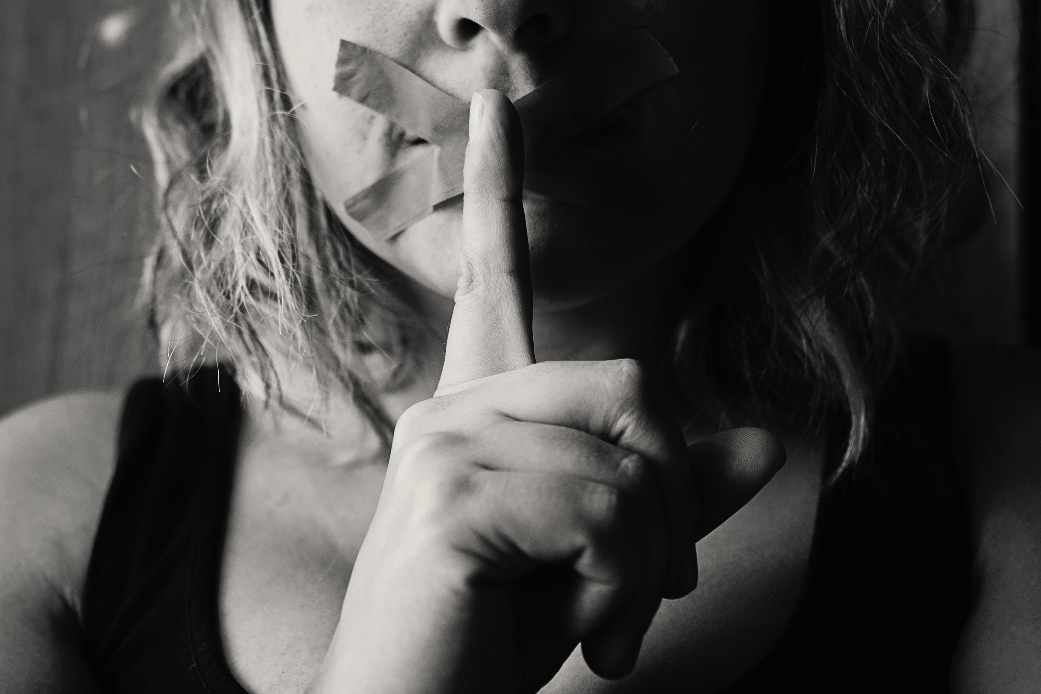 Woman Placing Her Finger Between Her Lips