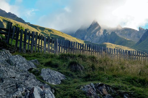 Brown Wooden Fence Beside Mountain