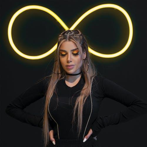 Woman on black background with yellow illumination