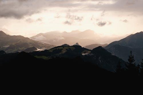 Black Mountains Under White Clouds