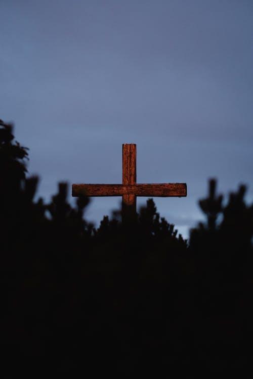 Brown Wooden Cross Under Gray Sky