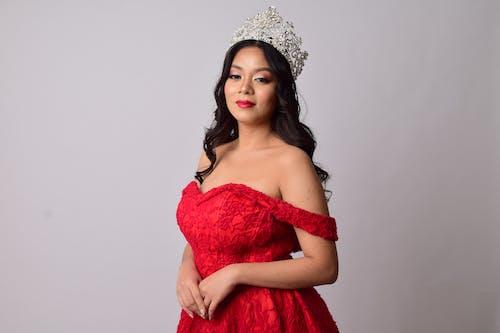 Woman in Red Dress Wearing Silver Tiara