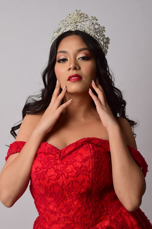 Woman Wearing Crown and Red Gown Dress