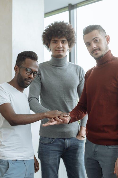 Men Hands Together Looking at Camera