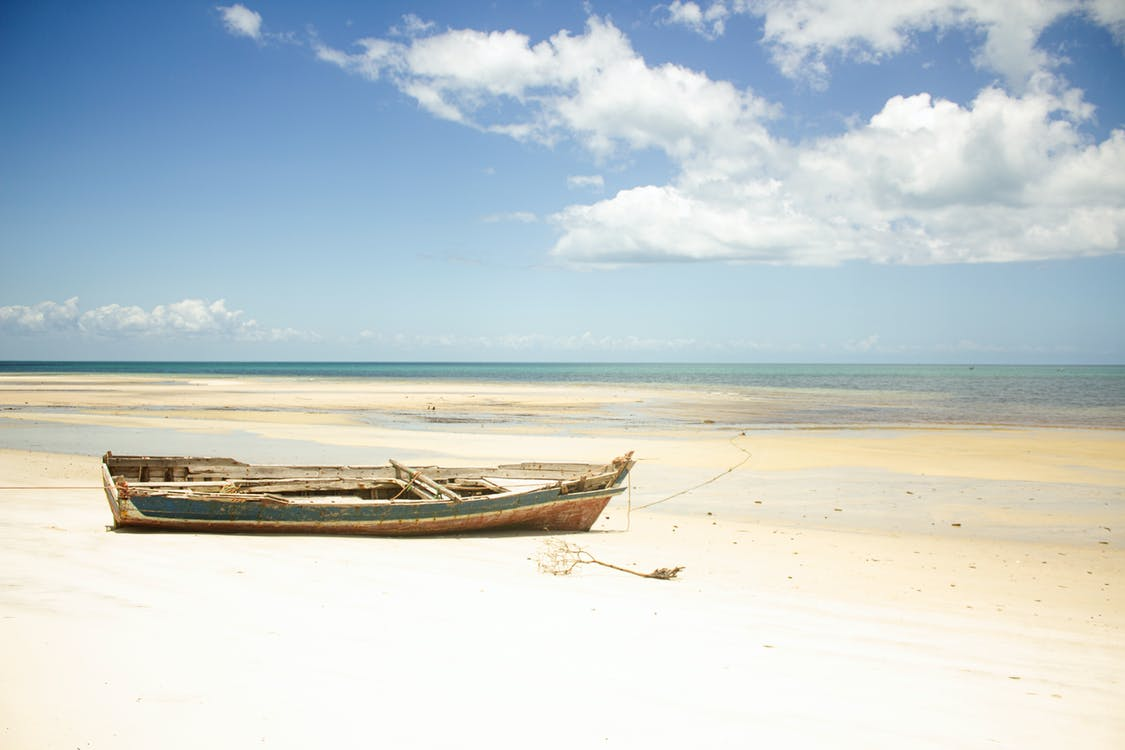 Abandoned Boat on the Beach Shore