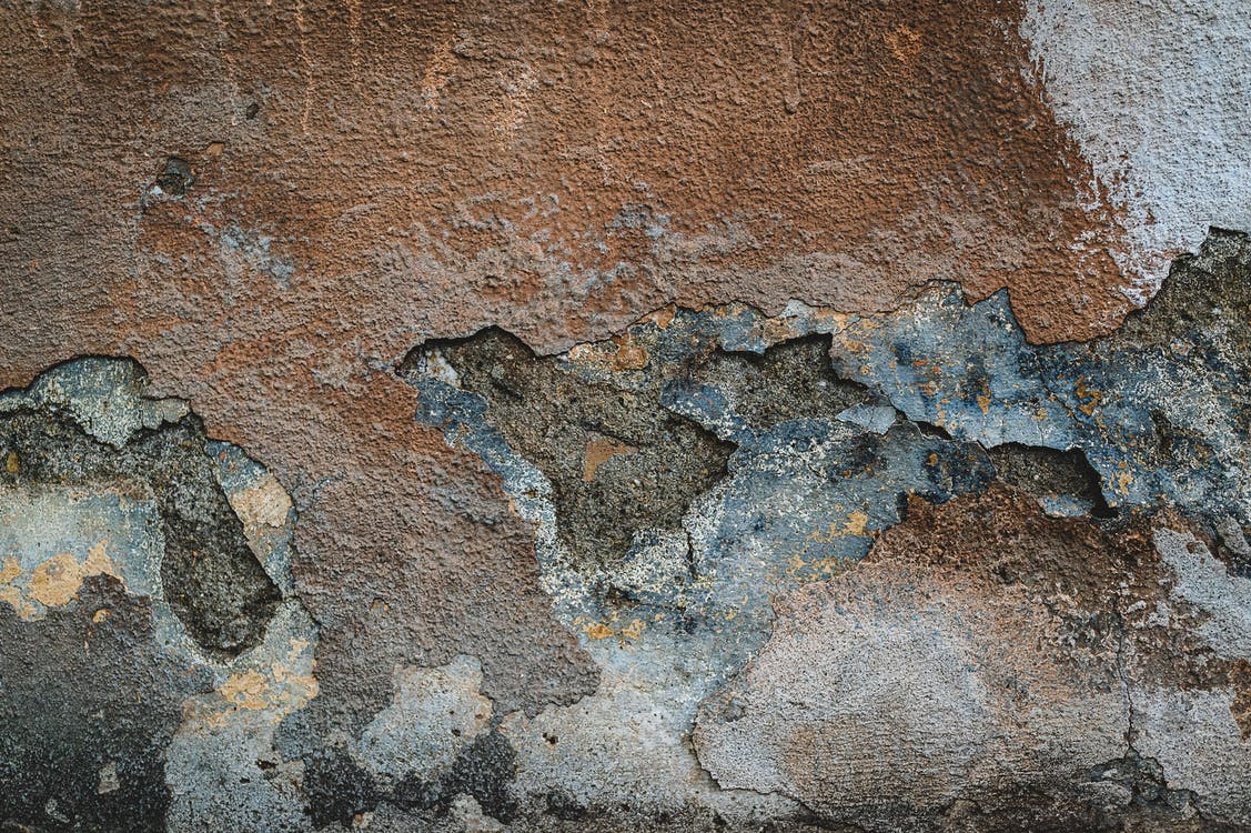 White and Gray Stone on Brown Concrete Wall
