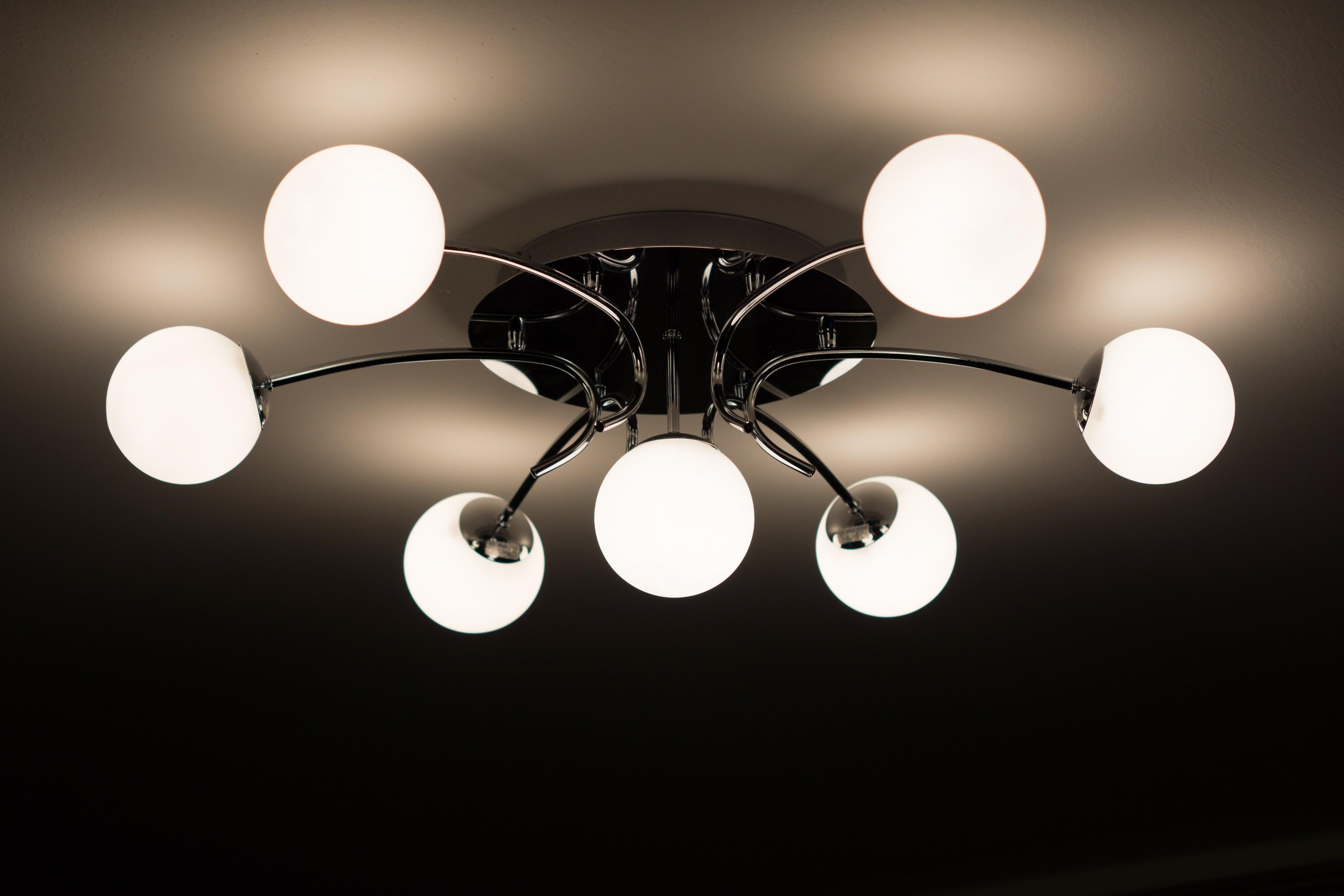 Silver Flush Mount Ceiling Light With Seven White Globe Lights