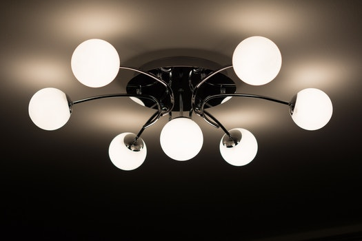 Silver Flush Mount Ceiling Light With Seven White Globe Lights
