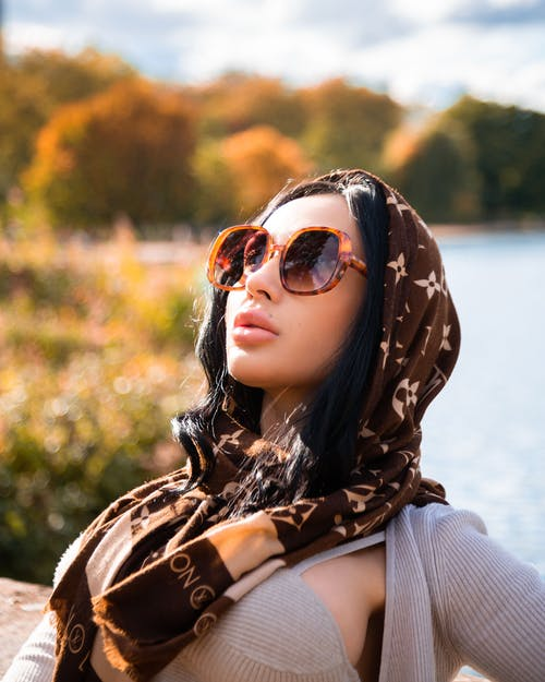 Woman in Brown Sunglasses and Scarf