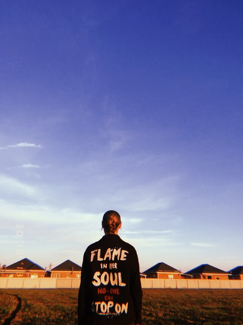 Person In Black Clothing Under Blue Sky