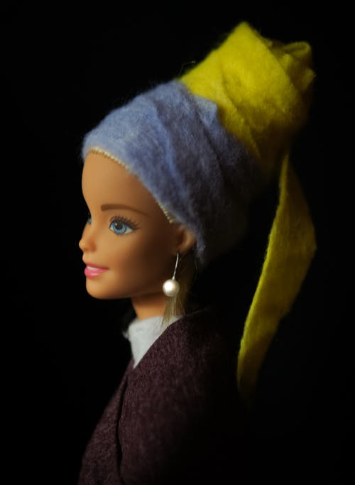 Doll with Blue and Yellow Head Wear