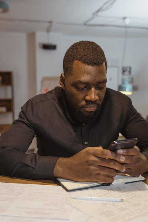 Close-up Photo of Man using Smartphone