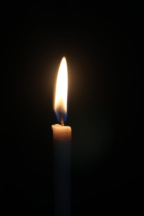 White Candle in Black Background
