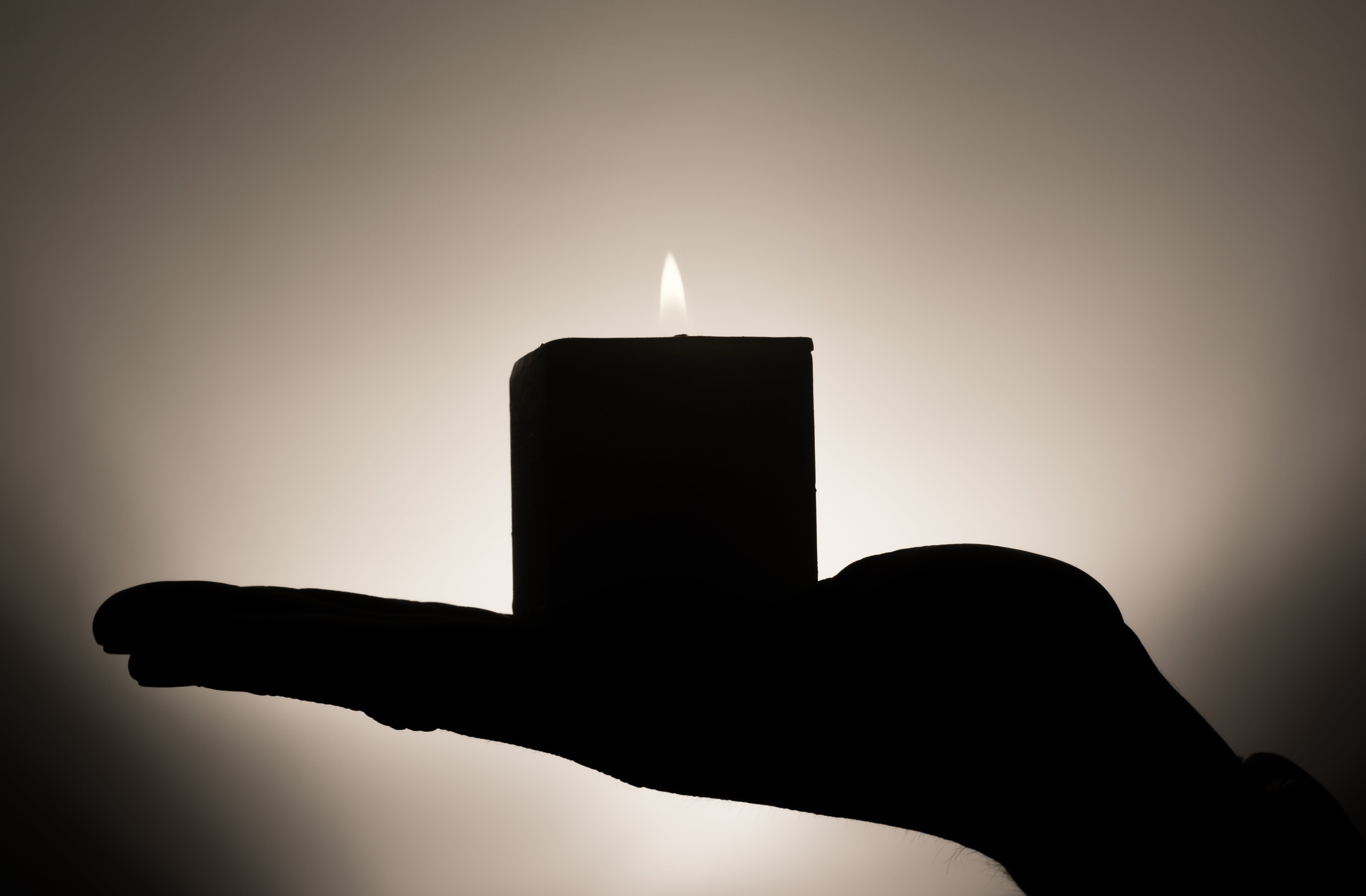 Free stock photo of hand, rest, shadow, candle