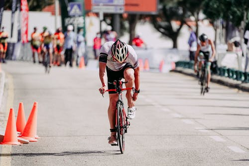 Anonymous bicyclists riding bikes on road during race