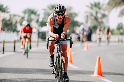 Determined cyclist riding bike on road during race