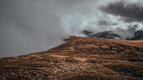 Thick clouds on mountain peak