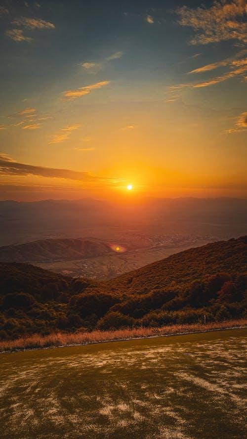 Sunset sky over mountainous terrain