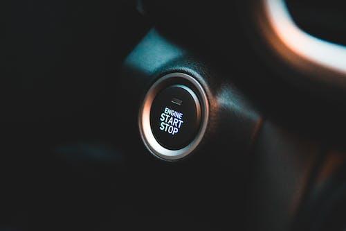 Convenient round button on black elegant dashboard of interior in contemporary comfortable automobile