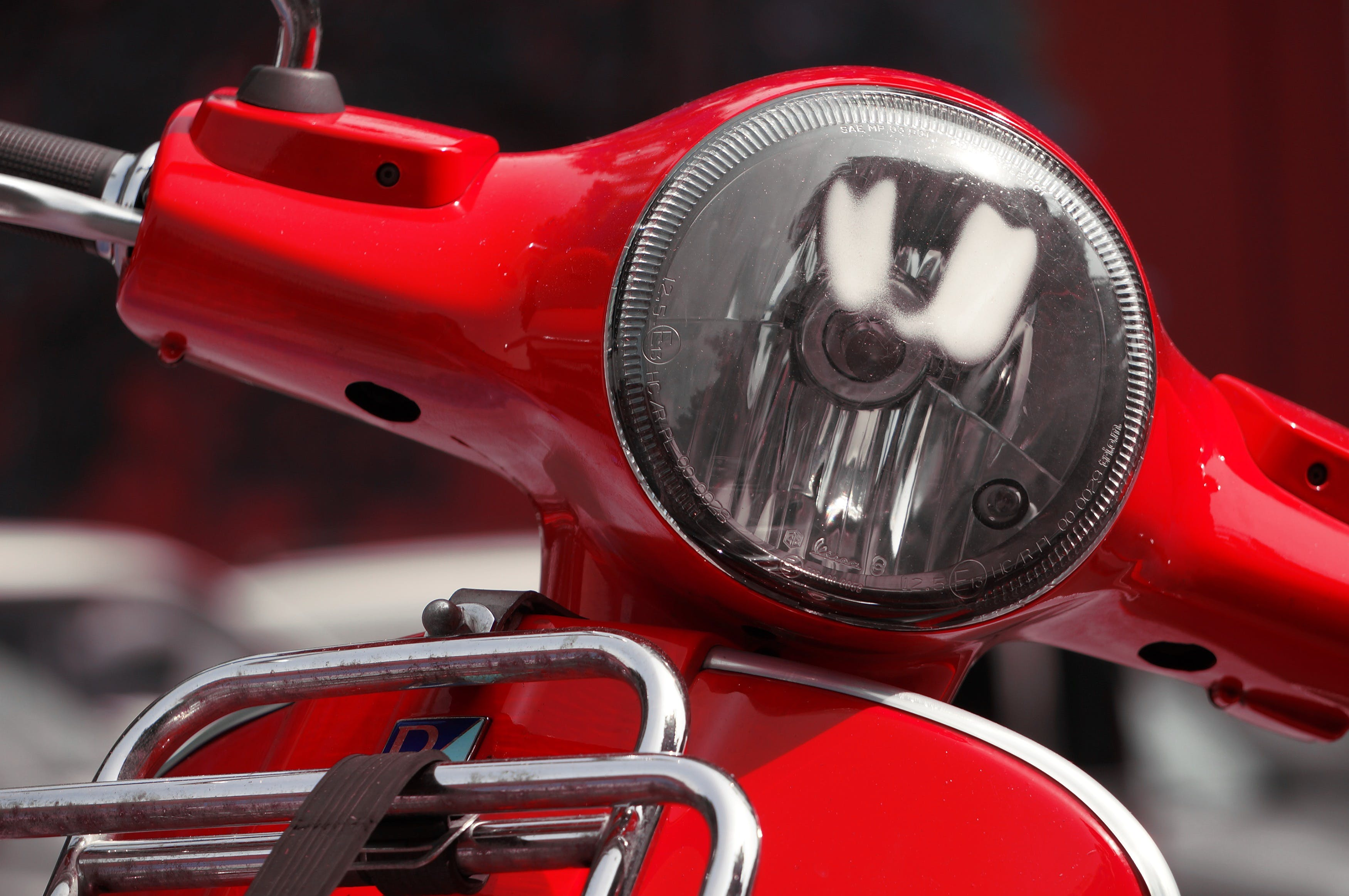 Silver Headlight on Red Motorcycle