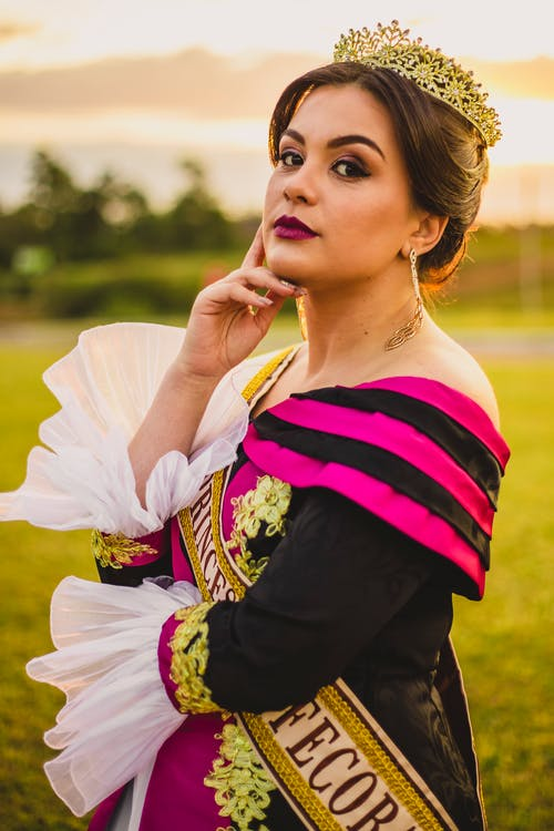 Stylish ethnic female model with makeup in countryside