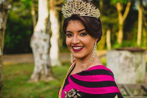 Pretty Woman Wearing Gold Crown