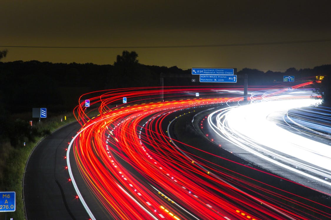 Time Lapse Photography of Car Passing by the Winding Road during Nighttime