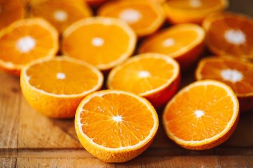 Sliced Orange Fruits on Wooden Surface