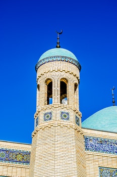 Brown Concrete Mosque Under Blue Sky during Daytime
