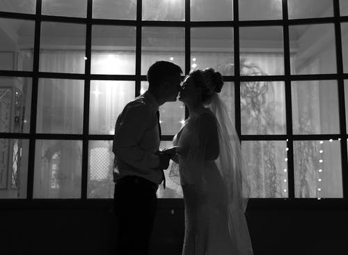 Bride and groom standing close to each other