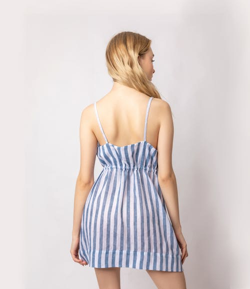 Young woman in striped dress in studio