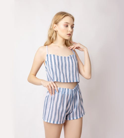 Female model in striped outfit in studio
