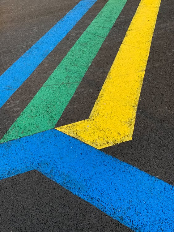 Yellow and Blue Line on Gray Asphalt Road