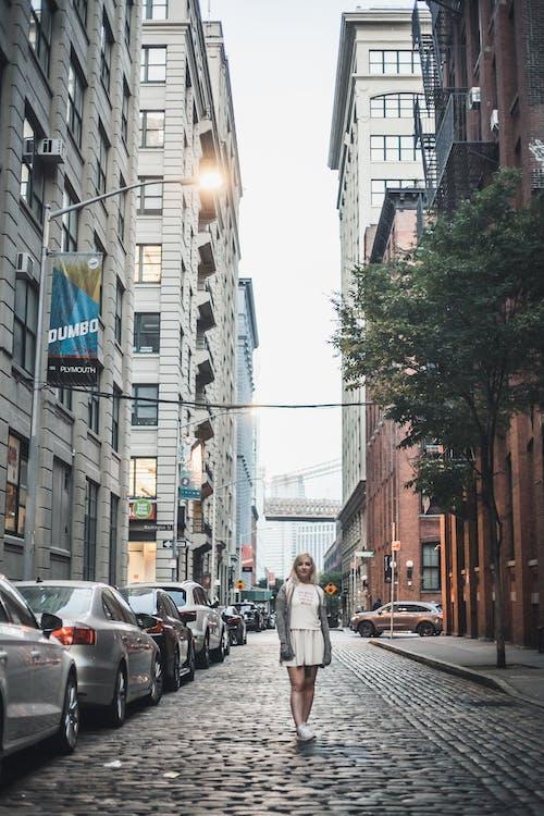 Man in Gray Coat Walking on Sidewalk