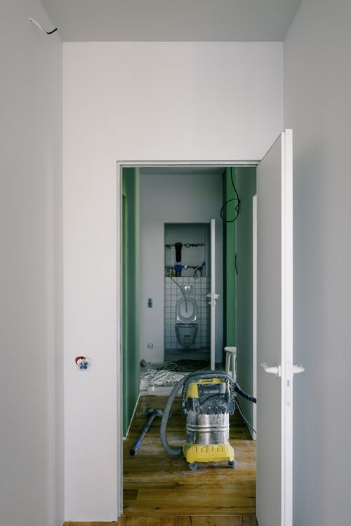 Toilet and vacuum cleaner in flat