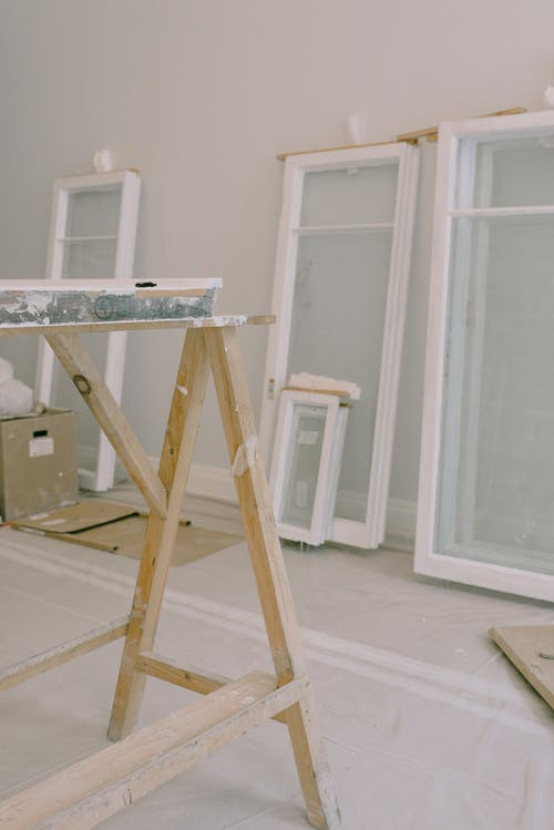 Interior of room under renovation with window frames