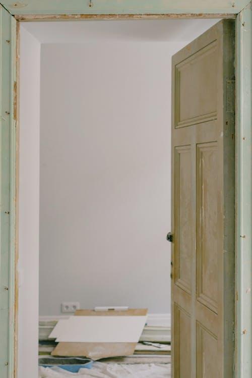 Open door in house with construction materials