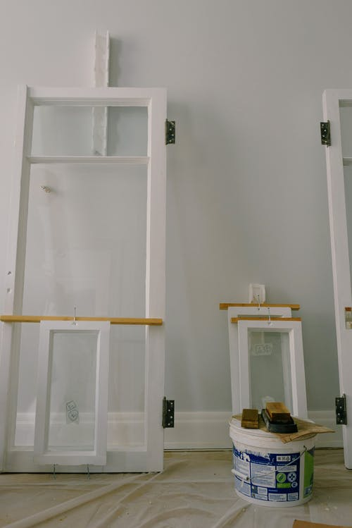 Window frames with hinges on floor in apartment