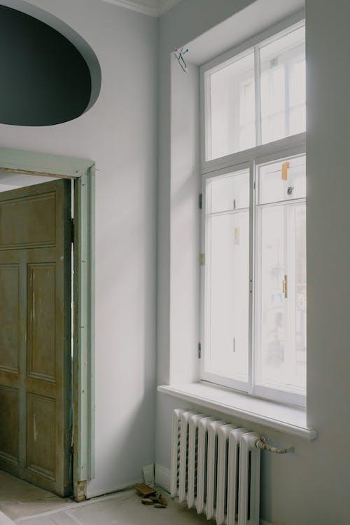 Shiny window above radiator in new apartment