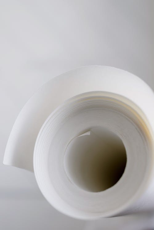 Closeup of white masking tape for repairing work against white background at home