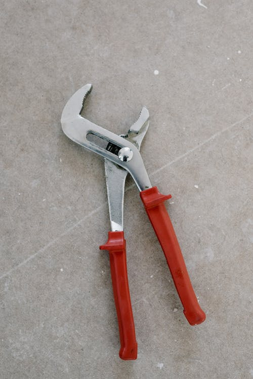 Pliers for repair on stone floor