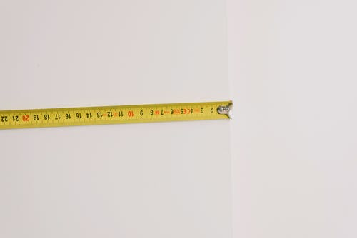 Measuring tape on empty white background